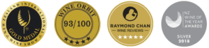 Row of four medals: Raymond Chan, Wine Orbit, NZ Wine of the Year, NZ International Wine Show
